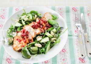 Spicy chicken tikka with greens, pomegranate and peanuts.